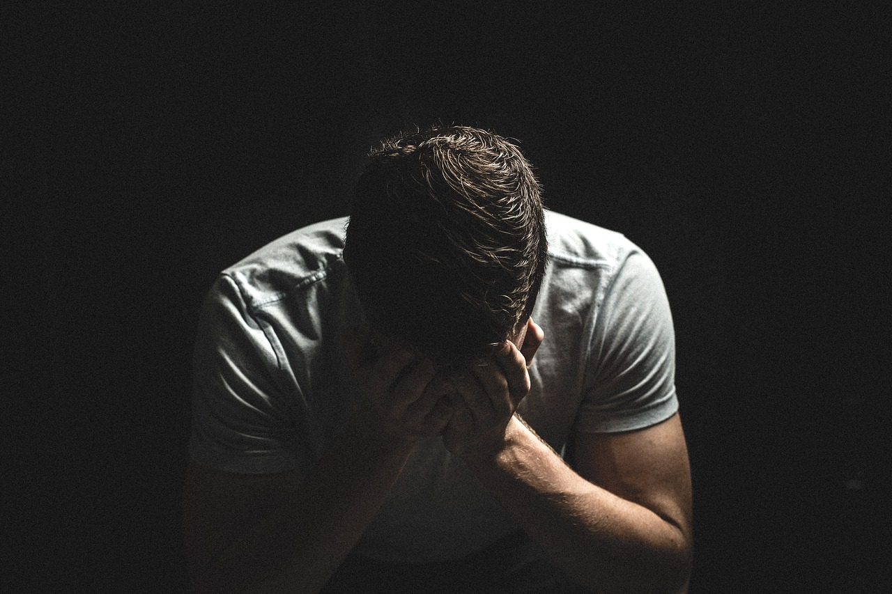 a man is crying because social anxiety is ruining his life