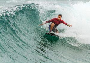 a surfing man