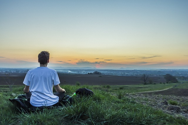 a man is meditating to help anxiety